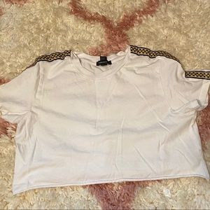 white crop top with checkerboard lining.